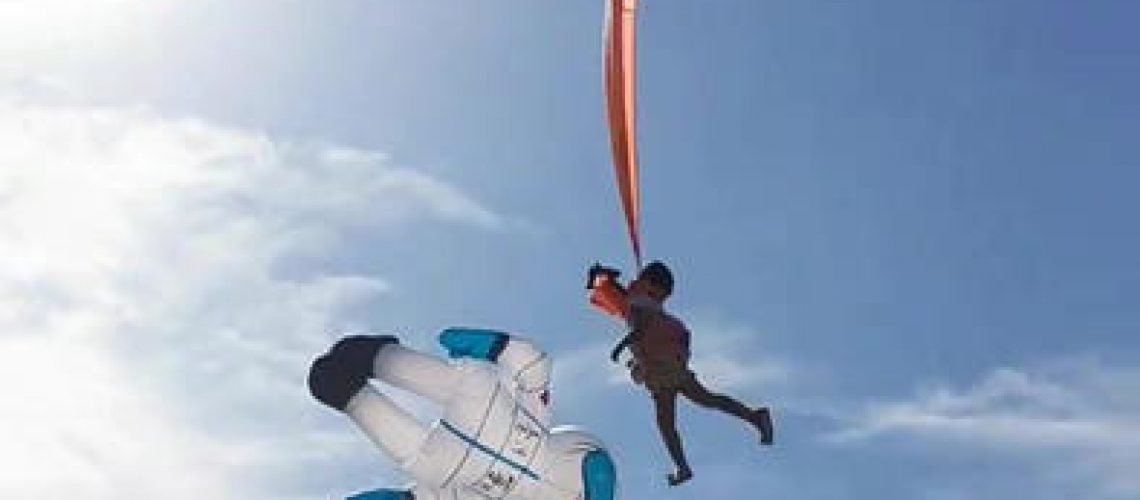 Taiwan girl pulled into sky by kite but landed with only bruises